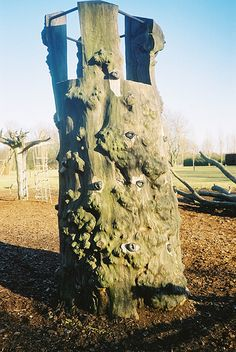 A tree converted into a play structure in this park designed by Helle Nebelong.