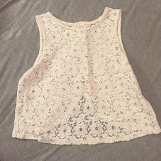 White, flowered tank top White, flowered tank top that buttons down and splits in the back. Size small. Worn a few times but in very good condition. Tops Tank Tops