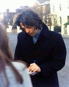 Paul signing an autograph, 1968