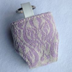 Cute Mini Cloth Nappy Keyring made with Oscha Liberty Islay wrap scrap Great accessory for your changing bag Fleece lined and working snaps  If you have any questions, please feel free to send me a message!  You can also find me on Facebook https://www.facebook.com/pages/Girls-Got-Fabric