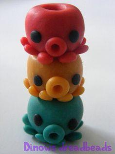www.etsy.com/shop/DinowsDreadbeads Custom or pre-made dread beads handmade of polymer clay.