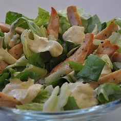 Light Caesar Salad bag of lettuce  2 handfuls cooked chicken chips 7 oz ( 200g ) plain Greek yogurt 1 tbsp mustard garlic clove  salt / pepper for taste