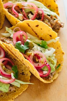 Truly amazing vegetarian tacos featuring easy-to-make refried beans, quick-pickled onions, and creamy avocado sauce! Your whole family will love these meatless tacos. Recipe yields 8 hearty tacos (about 4 servings). Vegetarian Tacos, Vegetarian Cabbage, Vegetarian Recipes, Healthy Recipes, Veggie Tacos, Vegetarian Cooking, Veggie Food, Vegetarian Taco Filling, Healthy Wraps