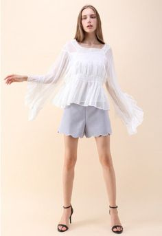 Hey, gorgeous! Give your closet a nice, white pick-me-up with this sheer dolly top with its cascading hemline and playful ruffles.   - Square neckline - Dramatic flare sleeves - Crochet embellished neckline, waist and cuffs - Pleated bust and hem - Not lined  - 100% Polyester - Hand wash  Size(cm)Length  Bust  Shoulder  Sleeves S/M                 57      108       46           42 Size(inch)Length Bust  Shoulder  Sleeves S/M               22.5    42.5      18          16.5  * S&#x2F...
