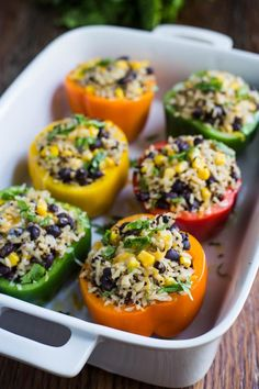 Burrito Bowl Stuffed Peppers- this recipe is VEGAN, super easy to make, and perfect for dinner or leftover lunches!! Something the whole family will love.