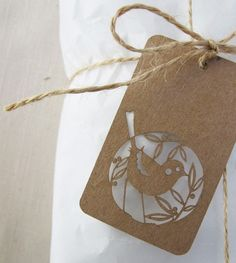 Kraft paper gift tags with twine {paper punch used for design}