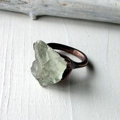 Midwest Alchemy - raw Prasiolite or green amethyst encompassed by a brushed, electroformed copper band.