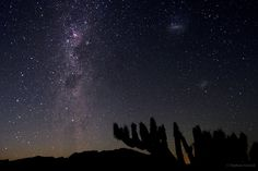 """Magellanic Clouds from the Atacama Desert. [Photo: Stephane Guisard-Astrosurf.com/sguisard (TWAN)] The two satellite galaxies of the Milky Way are in the upper right of the image - they do look like clouds! On the left side you can see the band of the southern Milky Way, an edge-on view of the disk of the Galaxy. Mona Evans, """"Milky Way - Facts for Kids"""" http://www.bellaonline.com/articles/art180135.asp"""