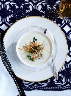 For a beautiful, almost bone-white soup, don't let the leeks and onion take on any color as they soften.