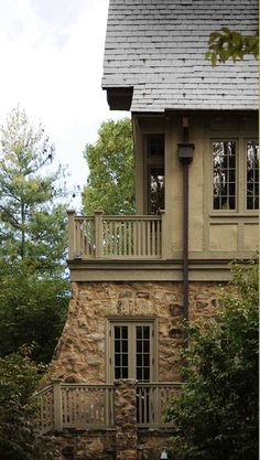 low contrast between stucco and trim colors makes the timber trim look more subtle