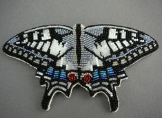 Posted by fyeahindigenousfashion: Scarce Swallowtail butterfly pin, Todd Lonedog Bordeaux (Lakota)