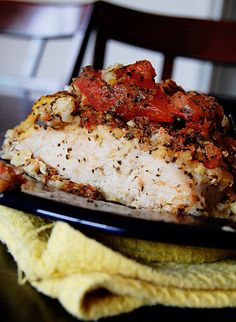 Bruschetta Chicken      1/2 cup flour  2 eggs, beaten  4 boneless, skinless chicken breasts  1/4 cup grated parmesan cheese  1/4 cup crushed garlic croutons  1 tablespoon butter, melted  2 large tomatoes  3 tablespoons minced fresh basil  2 garlic cloves, minced (appox. 1 teaspoon)  1 tablespoon olive oil  salt & pepper to taste    Preheat oven to 375 degrees. Grease 9x13 baking dish. Place f