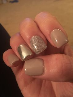 Chrome accent nail with nude polish and silver glitter.  Gel polish.
