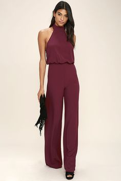It's time to grab your camera and capture every second in the Moment for Life Wine Red Halter Jumpsuit! This unforgettable woven number features a high mock neck (with back button closures), and a halter bodice with fitted waist. Attached trousers have hidden side seam pockets, and a chic wide-cut. Hidden back zipper.