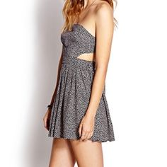 Cute summer dress Strapless with side cutouts to show off a little midriff. Dress ties around back. Dresses