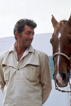 "Dean Martin on a movie set with ""Tops"" his favourite horse- undated."