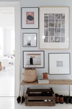 Giving a generous mat around one piece of artwork in a group hanging  allows breathing space for your collection.