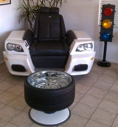 Auto inspired furniture pieces always get me going and the Ravin' Son Recliner is no exception. Custom made by Bartholomew O'Beirne of Artomotive Designs, this BMW M Series car inspired recliner boasts leather upholstery, functioning high and low beam headlights, real 19″ rims on axles, sound sensitive lighted wheel wells and a BOSE stereo system. ...