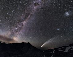 The Magellanic Clouds -- two gauzy patches of light (at far right) -- share the sky above the Patagonian Andes with a streaking comet and the luminous band of the Milky Way :: {National Geographic}