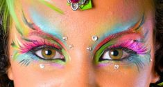 Here are some ideas to process. This is what fairy makeup should look like I guess. I have bright colors, black eye pencil and glue on mini stars. !!!