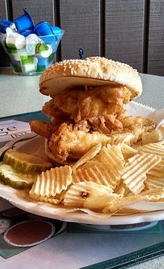 The Region: Northern Ohio  Where to Get It: New Sandusky Fish Company, Jolly Roger Seafood House, Village Inn  You'll find this fried-fish sandwich near Lake Erie. Perch is beer-battered or pan-fried and placed on a soft hamburger-style bun with lettuce, tomato, and onion. Ketchup, hot sauce, and tartar are all appropriate condiments. The fried-seafood sandwich actually isn't so different from the walleye — no wonder people often compare the two.