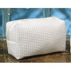 White WAFFLE WEAVE Cosmetic Makeup Toiletries travel bag NEW - Large size - by Pendergrass Inc. $7.25. Made of Cotton Waffle Fabric.. Machine Washable.. Fully lined inside.. Inside pocket.. The Cotton Waffle Cosmetic Bag is a great accessory to bring along on trips. Made out of cotton waffle fabric, the cosmetic bag is big enough to hold all of your toiletries and cosmetics yet small enough to fit in a suitcase or bring on a plane as your carryon. The Cotton Waffle Cosm...