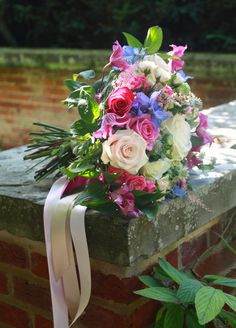 Blush & raspberry with hints of blue, add lovely ribbon trails for a beautiful summer bouquet.