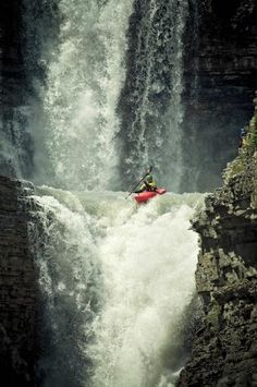 Mikkel St. Jean-Duncan kayaking the 50-foot waterfall Curtain Call at Bighorn River in the Canadian Rockies. Photo by Ryan Creary.