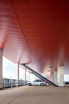 Project: Red Apple. Location: Rotterdam. Architect: KCAP Architecten & Planners Product: Hunter Douglas Wide Panel 300C Exterior Ceiling system. #red #architecture #ceilings# Rotterdam # KCAP architects #hunter douglas