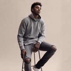 Nick Young for MR PORTER in John Elliot hoodie and jeans.