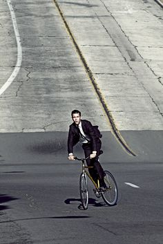 Men in suits on bikes. i'm not familiar with this, and if i saw it in person i think I'd really like it.