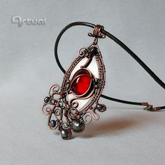 Art Nouveau wire pendant with red glass cabochon and by Artual