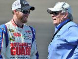Dale Jr talking to car / team owner Rick Hendrick