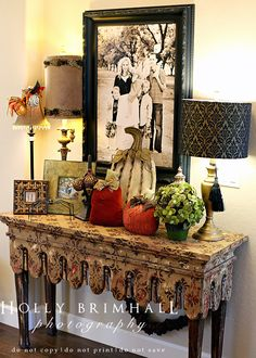 My sister's entryway.  She has an amazing eye for beauty.  I would never have thought to put three lamps on one table...but I love it!