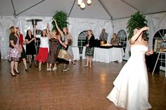 Wedding Reception bouquet toss at the Inn at Stonecliffe on Mackinac Island with Pluister Entertainment.