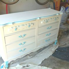 Repaint an old dresser with Krylon Fusion spray paint. No sanding or priming. Keep the old hard wear and spray it too.
