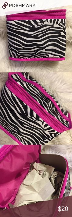 Hot pink and black zebra striped bag Cute bag, hot pink & black zebra print cosmetics bag. 2 zip top handle, brand new Bags Cosmetic Bags & Cases