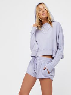 The Morning Run Set | You'll never want to take off this super comfy shorts set with matching hoodie.    * Washed, super soft fabric.   * Pullover is cropped to the natural waist.   * Subtle high low hem with unfinished trim in back. * Dolman style long sleeves. * Shorts have a drawstring waistband and hip pockets.   * Unfinished hem.