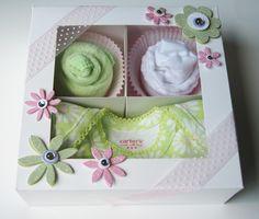 1 onesie, 1 washcloth, 1 pair socks in bakery box