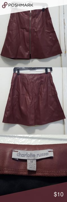 """NWOT Faux leather skirt Charlotte Russe faux leather wine mini skirt with front zipper. Never worn. Meassurement on flat surface: Waist: 13.5"""" Length: 17.5"""" Excellent conditions. No trades :( Charlotte Russe Skirts Mini"""