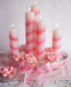 candy-striped candles and pink roses