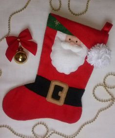 Bota natalina Papai Noel.Toda em feltro. <br>Não inclui a decoração usada na foto. <br>Mede 50 cm