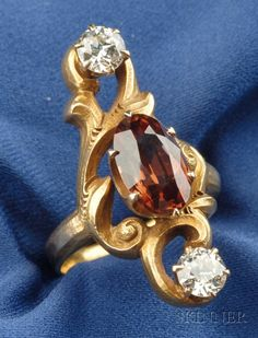 Art Nouveau 14kt Gold, Zircon and Diamond Ring, prong-set with an oval-cut zircon and two old European-cut diamonds, mount with scrolling fr...