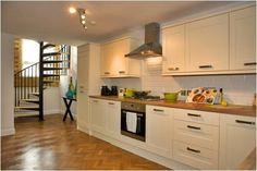 Cabinets modularkitchen kitchen new avondale ivory for Kitchen ideas magnet