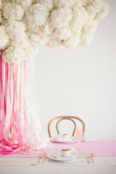 Gorgeous white hydrangea display with falling pink ribbons