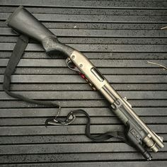 Remington 870 with Surefire fore-end, Trijicon rifle sights.Nice home defense shotgun. Take off the sling for home defense.