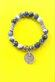 Beaded stretch bracelet with sodalite gemstone-silver coin pendant - blue