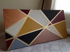 Made this for a JDRF auction item. Spray paint metallic gold on canvas, placed drafting tape down to create shapes, added acrylic paint. Let dry and peel off tape. Super easy!