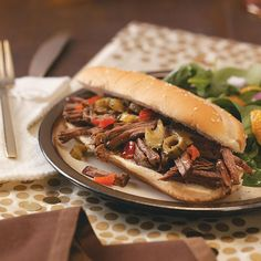 Chicago-Style Beef Sandwiches Recipe -I'm originally from the Windy City so I love Chicago-style beef. These tender sandwiches lend an authentic flavor, and they're so simple to prepare using a slow cooker. —Lois Szydlowski, Tampa, Florida