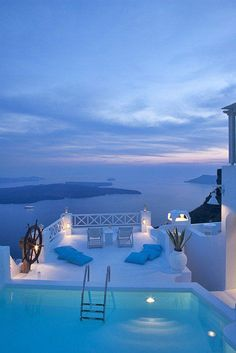 Santorini Islands in Greece are known for their white architecture against the blueness of the sky and sea which makes for a relaxing vacation spot.